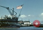 Image of USS Nevada leaving drydock after repairs Pearl Harbor Hawaii USA, 1942, second 20 stock footage video 65675062939