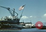 Image of USS Nevada leaving drydock after repairs Pearl Harbor Hawaii USA, 1942, second 21 stock footage video 65675062939