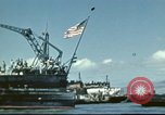Image of USS Nevada leaving drydock after repairs Pearl Harbor Hawaii USA, 1942, second 22 stock footage video 65675062939
