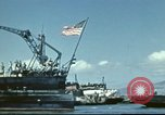 Image of USS Nevada leaving drydock after repairs Pearl Harbor Hawaii USA, 1942, second 24 stock footage video 65675062939