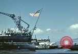 Image of USS Nevada leaving drydock after repairs Pearl Harbor Hawaii USA, 1942, second 25 stock footage video 65675062939