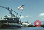 Image of USS Nevada leaving drydock after repairs Pearl Harbor Hawaii USA, 1942, second 27 stock footage video 65675062939