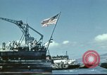 Image of USS Nevada leaving drydock after repairs Pearl Harbor Hawaii USA, 1942, second 28 stock footage video 65675062939