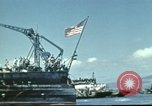Image of USS Nevada leaving drydock after repairs Pearl Harbor Hawaii USA, 1942, second 30 stock footage video 65675062939