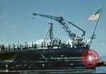 Image of USS Nevada leaving drydock after repairs Pearl Harbor Hawaii USA, 1942, second 32 stock footage video 65675062939