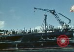 Image of USS Nevada leaving drydock after repairs Pearl Harbor Hawaii USA, 1942, second 34 stock footage video 65675062939