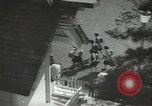 Image of Japanese children bow at shrine on the way to school Japan, 1939, second 3 stock footage video 65675062944