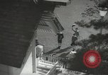Image of Japanese children bow at shrine on the way to school Japan, 1939, second 7 stock footage video 65675062944