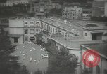 Image of Japanese children bow at shrine on the way to school Japan, 1939, second 9 stock footage video 65675062944