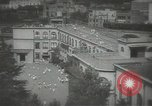 Image of Japanese children bow at shrine on the way to school Japan, 1939, second 10 stock footage video 65675062944