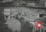 Image of Japanese children bow at shrine on the way to school Japan, 1939, second 13 stock footage video 65675062944