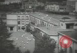 Image of Japanese children bow at shrine on the way to school Japan, 1939, second 14 stock footage video 65675062944