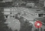 Image of Japanese children bow at shrine on the way to school Japan, 1939, second 15 stock footage video 65675062944