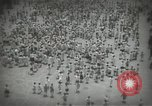 Image of Japanese children bow at shrine on the way to school Japan, 1939, second 16 stock footage video 65675062944