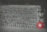 Image of Japanese children bow at shrine on the way to school Japan, 1939, second 20 stock footage video 65675062944