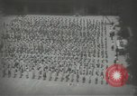 Image of Japanese children bow at shrine on the way to school Japan, 1939, second 21 stock footage video 65675062944