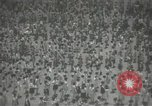 Image of Japanese children bow at shrine on the way to school Japan, 1939, second 26 stock footage video 65675062944