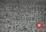 Image of Japanese children bow at shrine on the way to school Japan, 1939, second 27 stock footage video 65675062944