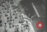 Image of Japanese children bow at shrine on the way to school Japan, 1939, second 29 stock footage video 65675062944