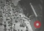 Image of Japanese children bow at shrine on the way to school Japan, 1939, second 30 stock footage video 65675062944