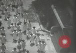 Image of Japanese children bow at shrine on the way to school Japan, 1939, second 31 stock footage video 65675062944