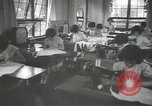Image of Japanese children bow at shrine on the way to school Japan, 1939, second 32 stock footage video 65675062944