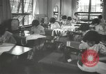 Image of Japanese children bow at shrine on the way to school Japan, 1939, second 34 stock footage video 65675062944