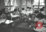 Image of Japanese children bow at shrine on the way to school Japan, 1939, second 35 stock footage video 65675062944