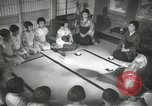 Image of Japanese children bow at shrine on the way to school Japan, 1939, second 36 stock footage video 65675062944