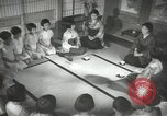 Image of Japanese children bow at shrine on the way to school Japan, 1939, second 37 stock footage video 65675062944