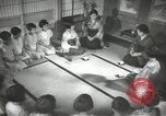 Image of Japanese children bow at shrine on the way to school Japan, 1939, second 38 stock footage video 65675062944