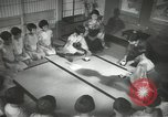 Image of Japanese children bow at shrine on the way to school Japan, 1939, second 39 stock footage video 65675062944