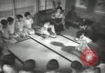 Image of Japanese children bow at shrine on the way to school Japan, 1939, second 40 stock footage video 65675062944
