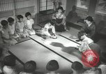Image of Japanese children bow at shrine on the way to school Japan, 1939, second 41 stock footage video 65675062944