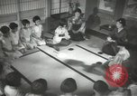 Image of Japanese children bow at shrine on the way to school Japan, 1939, second 42 stock footage video 65675062944