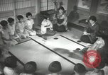 Image of Japanese children bow at shrine on the way to school Japan, 1939, second 43 stock footage video 65675062944