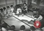 Image of Japanese children bow at shrine on the way to school Japan, 1939, second 44 stock footage video 65675062944