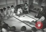 Image of Japanese children bow at shrine on the way to school Japan, 1939, second 45 stock footage video 65675062944