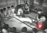 Image of Japanese children bow at shrine on the way to school Japan, 1939, second 46 stock footage video 65675062944