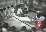 Image of Japanese children bow at shrine on the way to school Japan, 1939, second 47 stock footage video 65675062944