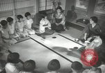 Image of Japanese children bow at shrine on the way to school Japan, 1939, second 48 stock footage video 65675062944