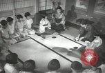 Image of Japanese children bow at shrine on the way to school Japan, 1939, second 49 stock footage video 65675062944