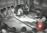 Image of Japanese children bow at shrine on the way to school Japan, 1939, second 50 stock footage video 65675062944