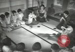 Image of Japanese children bow at shrine on the way to school Japan, 1939, second 52 stock footage video 65675062944