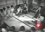 Image of Japanese children bow at shrine on the way to school Japan, 1939, second 53 stock footage video 65675062944