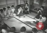 Image of Japanese children bow at shrine on the way to school Japan, 1939, second 54 stock footage video 65675062944