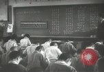 Image of Japanese children bow at shrine on the way to school Japan, 1939, second 56 stock footage video 65675062944