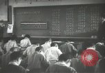 Image of Japanese children bow at shrine on the way to school Japan, 1939, second 57 stock footage video 65675062944