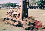 Image of Digging air raid shelters in Hawaii at start of World War II Hawaii USA, 1942, second 10 stock footage video 65675062971
