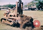 Image of Digging air raid shelters in Hawaii at start of World War II Hawaii USA, 1942, second 13 stock footage video 65675062971